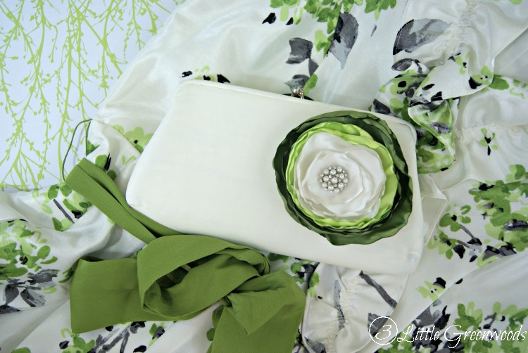 Need a cute, inexpensive purse for date night? Upcycle a Thrift Store Purse into a fabulous DIY Clutch Purse! Beautiful satin rose customizable for any occasion! #DIYClutchPurse #DIYHandbag