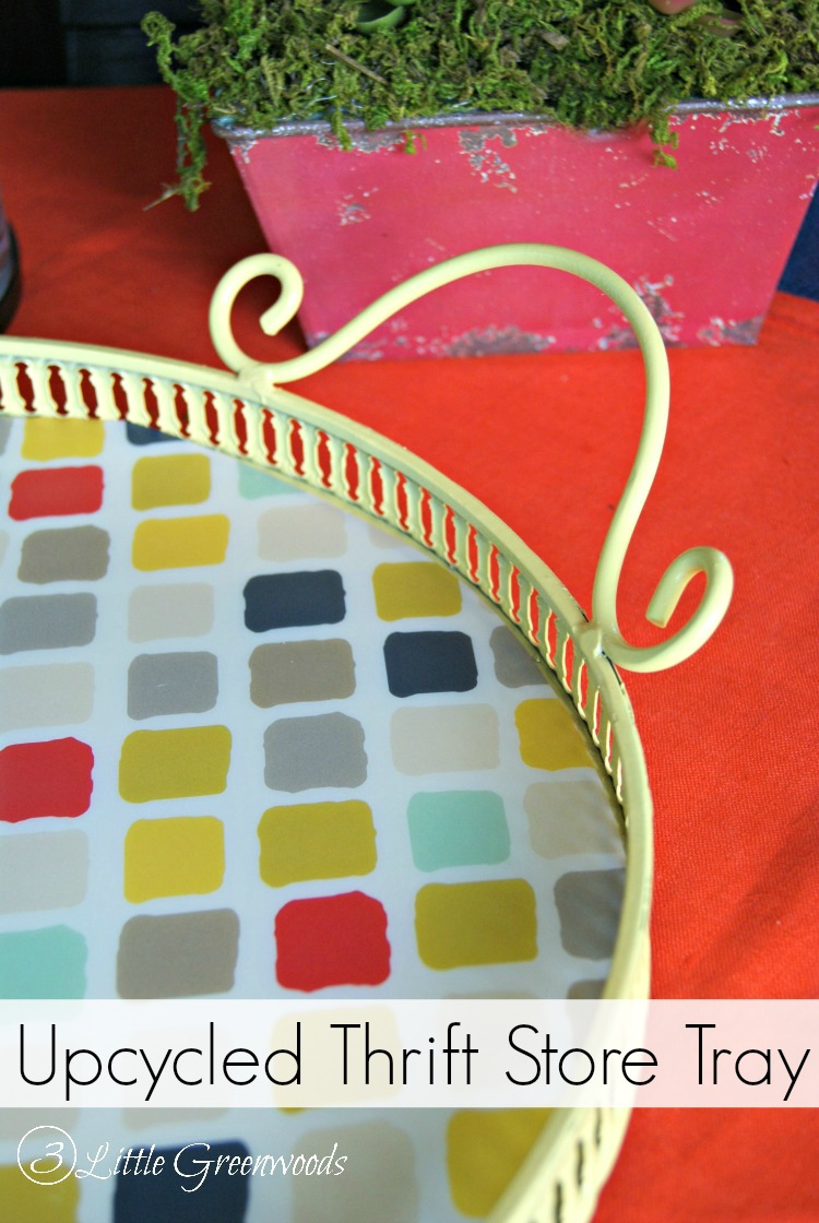 I love this idea for an Upcycled a Thrift Store Tray with spray paint and a patterned plastic placemat! Such a quick and easy way to transform an inexpensive item into a cool table decorating idea! by 3 Little Greenwoods