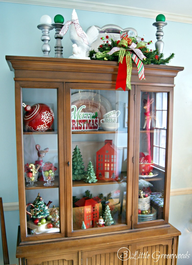 Beautiful Christmas Home Tour with lots of great Christmas decorating ideas for the Dining Room! LOVE the Christmas China Cabinet! by 3 Little Greenwoods