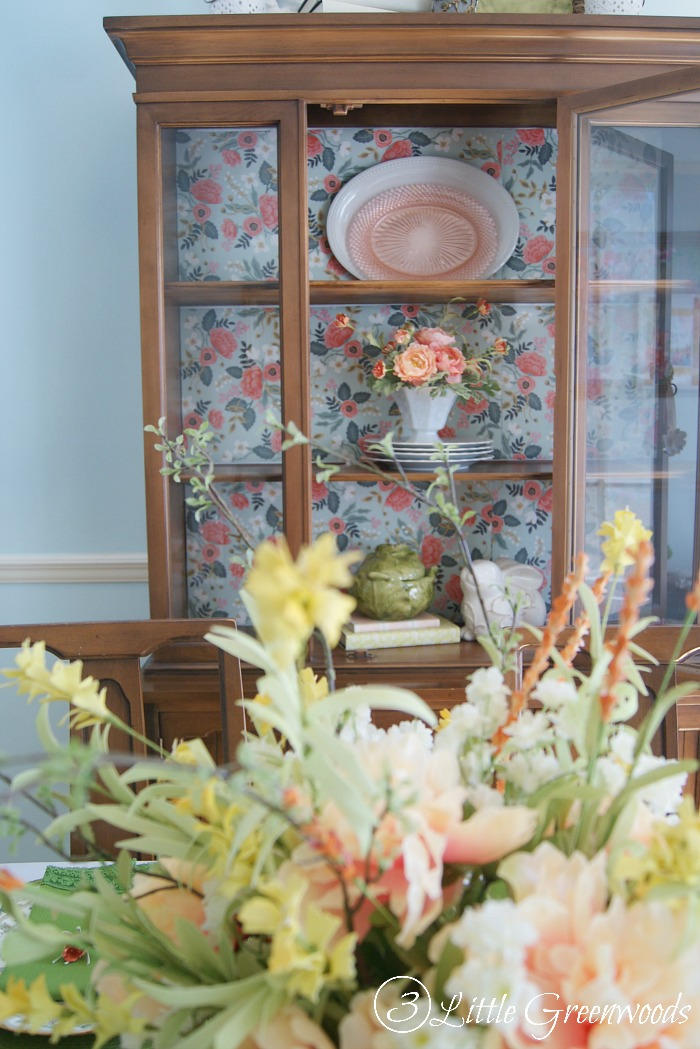 You don't have to paint that family heirloom! Here's a China Cabinet Makeover without Painting by using wrapping paper to add color and pattern.