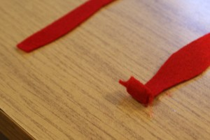 Cut the felt into a wavy strip then begin the rose by tightly rolling the center gluing all the way.
