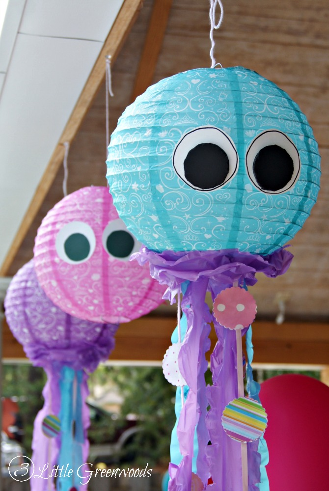 Create your own DIY Little Mermaid Birthday Party Decor: DIY Lantern Jellyfish https://www.3littlegreenwoods.com