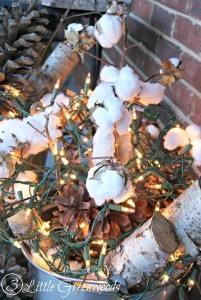 Simple Front Porch Rustic Christmas Door with Cotton Branches, Beech Logs, Pine Cones, and White Lights by 3 Little Greenwoods
