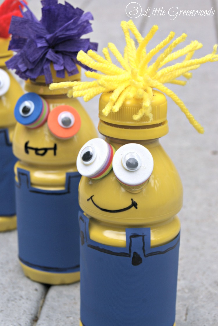 Looking for simple Summer Fun Activities for Kids? Spend the day making these fun Minions from recycled apple juice bottles and items you already have at home! Make A Minion Craft by 3 Little Greenwoods