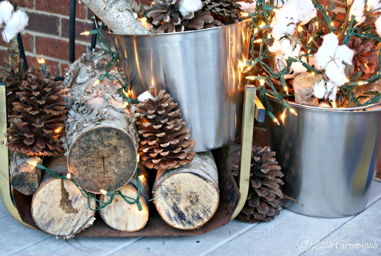 Don't give up the lights of holidays yet! Decorate with these Front Porch Ideas for Winter using cotton and birch logs! Perfect and simple winter decorations by 3 Little Greenwoods