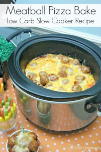 AWESOME slow cooker recipe for Meatball Pizza Bake that's perfect for football snacks! Italian meatballs, pepperoni, and tangy sauce topped with gobs of gooey cheese! One of our favorite crockpot recipes! // 3 Little Greenwoods