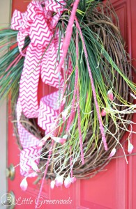 How to Make a Spring Wreath in less than 10 minutes! This quick and easy wreath uses only four supplies. It can be a beautiful Easter wreath to dress up your front door. Plus this easy grass wreath will last through the summer!