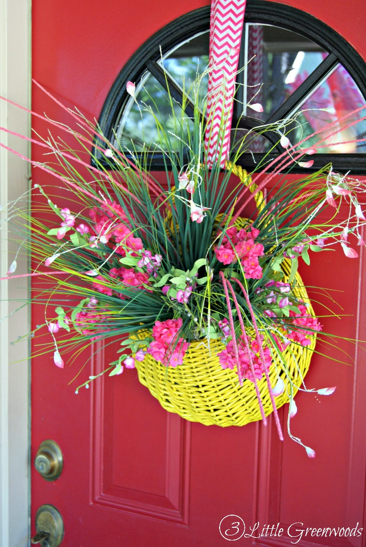Fabulous Thrift Store Find turned into a Spring Basket Wreath! Love the color and can't wait to fill it with lots of colorful spring flowers! Awesome front door idea with a door basket! // 3 Little Greenwoods