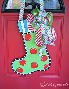 Forget a boring Christmas wreath! I'm making this Christmas Stocking Door Hanger. It's a Dollar Store Christmas project you will love!