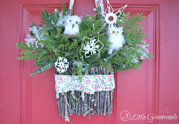 With just a few craft supplies, white owls, and greenery from your yard, anyone can make this simple owl wreath! Perfect Owl Wreath for a Winter Front Door!