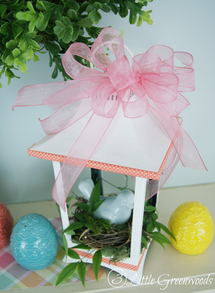 Spring decorating with a white lantern centerpiece is perfect for a mantel or Easter tablescape! Awesome update of a thrift store find into spring decor.