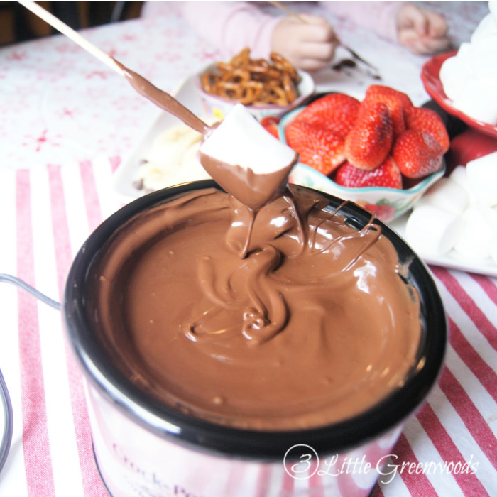 Oh my word! This 2 ingredient Crockpot Chocolate Fondue Recipe is AMAZING! Perfect for dessert parties or a Valentine's Day special dinner.